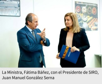La Ministra, Fátima Báñez, con el Presidente de SIRO, Juan Manuel González Serna